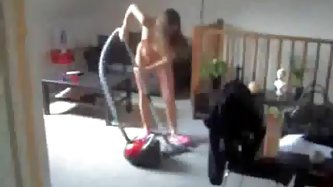 Skinny naked wife hoovering apartment wearing just a pair of pink slippers.