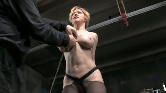 Submissive slim bitch with tied up big tits stands on knees and gets her mouth invaded with BBC and white sugary one.Watch that hard BDSM FMM porno in