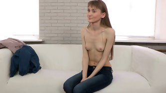 Lovely girl with extremely slim body and tiny boobs takes her clothes off and shows off her naked body. she talks to the interviewer and opens her sma