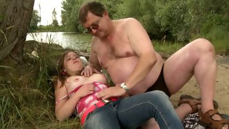 Adorable teen chick with pigtails gets great pussy licking from a skillful old man under the tree by the river. Watch the teen sweetie seduced and ple