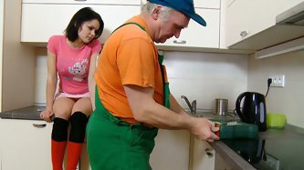 Adorable teen sweetie sits on the kitchen while an aged plumber doing his job. When the work's done grandpa wants get the cutie's pussy inst