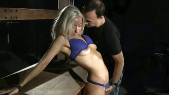 Tied up blonde Alena makes faces till the hard ass slapping inflame her fleshy sexy ass. Than, she gets a submissive slave girl and takes the cock dee