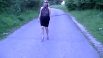 Amateur wife using a see through hot club dress flashing her tits in a public park.