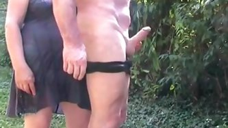 Watch my mature husband and me playing dirty games in the garden. I spank the man's butt, then take his wang out of his pants and show my handjob