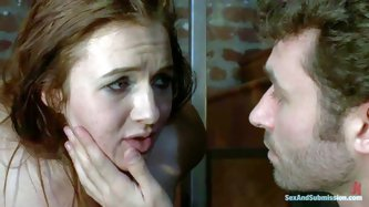 Brown haired slave girl Ashli Orion is naked to be punished by crazy man James Deen. He gets face fucked by hard dicked guy who loves playing with her