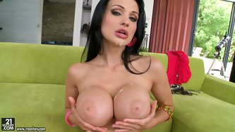 Extremely busty bitch Aletta Ocean in on her knees geerily sucking two huge monster cocks in a sloppy way. She spits on her huge boobs and later gets
