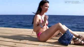 Tight brunette Aurita in tiny bikini flashes her perky tits and clean pussy in public places in Egypt in this nice video. She goes crazy about sex adv