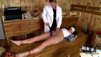 Perverse doctor uses rope ti tie a fuckable patient to the bed and tape her mouth while she is asleep. Later he starts drilling her tiny pussy with vi