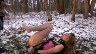 Juicy teen tries to run away from her master on cold snowy day wearing only lingerie. Cutie gets her natural tits rubbed with snow and then gets suspe