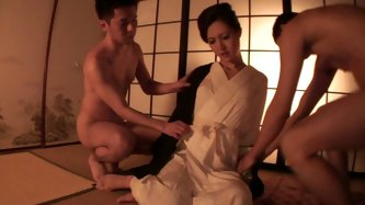 She is a hot Asian slut who can serve two men simultaneously. Her lips slide one cock and her feet jerk another one at a time. Just enjoy this traditi
