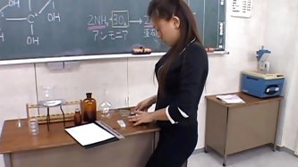 Pretty AV model is in class waiting for her teacher to come in for a detention. She shows him her big tits and he plays with them and she rubs his coc