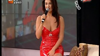 Upskirt and Downblouse Turkish singer Tuba Ekinci ...