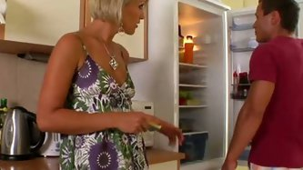 Hot like fire blond wife attacks her husband's cock in the kitchen. She sucks it intensively and jerks it off from time to time. She also polishe