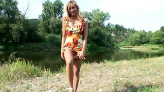 Seductive blond mature rides to the country with her young lover. They stop by the pond where she sucks his long cock rapaciously before she rides it