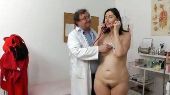 Fuckable brunette mom Nadezda attends her doctor for medical examination. He mauls her slack tits before she lays on the lounge totally naked.