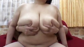 This Japanese slut has enormous sized boobs.  She shakes her big melons teasing your rocky cock. Even the monstrous dick will disappear in her cleavag