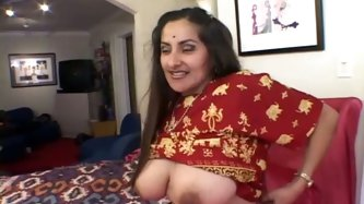 Busty Indian mature gets her slack oversized tits oral stroked by kinky fucker before she lies on her back to get fucked in missionary style while suc