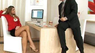 She is a graceful office assistant with beautiful long legs. Her boss has a fetish for neat feet so he asks her to show her toes. When he faces her to