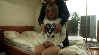 Hot Japanese babe Tomomi is sitting obidiently on the bed. He takes off her top fondles her big boobs and vibrates her pussy. Then she gives blowjob.