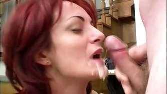 Whorish red haired old bitch is caught while rubbing her wet mature pussy on the table. Pale wrinkled and kinky whore has nothing against being fucked