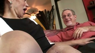 This busty mature brunette doesn't mind to have filthy sex on the couch. She undresses and gives sloppy head to a mature man!