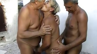 Insatiable fat granny lies on bench totally naked while two old geezers suck her big tits and rub her dirty hairy muff. That old hussy loves sucking f