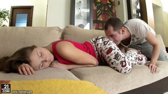 Horny boyfriend of Lizzie wakes her up by kissing her tender neck. She wants more and dude starts eating her sweet shaved pussy right on the couch.