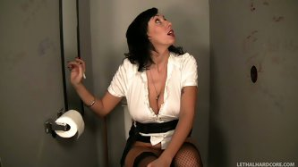 She sits on a toilet pan in a public toilet and sees the dick of some stranger that is sticking out of the hole in the wall. She takes it in her mouth