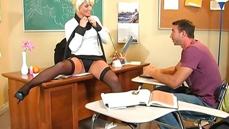 Whorish blonde teacher flirts with young dude and spreads her stocking legs wide. He dives in her muff and gives her good tongue job.