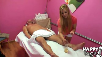 Divine blond masseur is busy giving a zealous erotic massage to strain beefy dude. She rubs his back later switching to belly before she takes off her