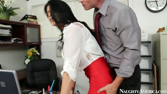 Sex hungry bald boss makes out with a sextractive office manager right in his office. He bends her over a table to give her a rimjob before she stands
