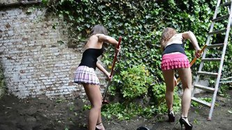 2 lesbians gardening in muddy high heels (+upskirt) - Outdoor porn tube video
