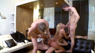 Experienced blonde hoe is serving three horny studs. Two of them bang her both fuck holes at once while she sucks the third one.