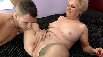 Hot blonde mature whore Mrs Jewell in stockings has big experience in blowjobs. She sucks dick. Then he takes off her clothes and eats her pussy.
