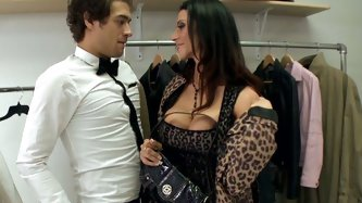 Rich cougar with huge boobs seduces handsome man for sex. She pulls his dong out of his pants and takes hard flesh in her mouth. She also licks balls