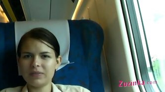 She is riding in a public train. She wears white skirt but no undies. Zuzinka opens her legs flashing her pussy on cam. It turns her on so she wets th