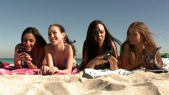 This is a great vid! We've got four sweet honeys hanging out at the beach, showing off their asses and tits. You can tell they are all so horny,