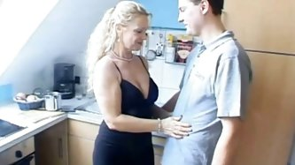 Whorish mature slut with droopy jugs posed on knees and got to blow staff penis of her thirsting young stud right at kitchen before dinner. Watch that