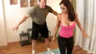 A sexy flexible bitch stretches on a floor. When her student enters the room she starts showing him poses and techniques in yoga. He accidentally hurt