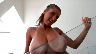 Hell attractive babe has got huge boobs. She shakes and bounces her jugs. Then she pushes her bust against the glass. Check out this awesome Reality K