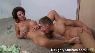 Busty brunette is laying naked on the floor of new apartment. They want to celebrate their purchase by fucking in missionary position, giving blowjob