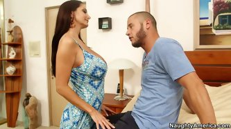 Full-bosomed bombshell Ava Addams unleashes her wild side. She bends over to give her boyfriend a great blowjob and titjob.