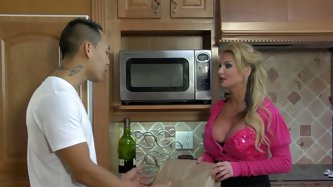 Horny blonde mommy Taylor Wane likes handsome young Asian guy! She seduces him with her big boobs and blows his cock! He also wants to lick her milf p