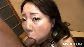 This short haired Japanese milf prefers to wear swimsuit, cause she thinks she looks slimmer in it. Kneeling down she starts sucking dick, till it loa
