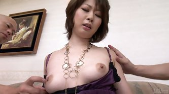 Rio Kagawa exposes her nipples and gets them fondled and squeezed by to horny guys. Then she gets her shaved  pussy licked.