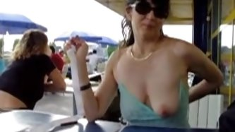 Amateur wife showing her lovely tits in a public restaurant. Its a little naughty, but this kind of things excite anyone. More