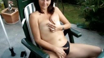 Elizabeth loves sitting topless under the sun and getting some tan. She feels so good she starts masturbating and doesn`t mind me making videos of her