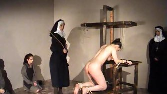 Nun gives a girl 50 lashes with a cane - Spanking Porn