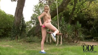 Cute innocent looking blonde teen Chlo Toy with long legs and natural boobies in short blue skirt stuffs shaved tight cunny and sweet firm ass with pi