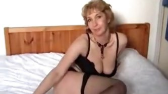 Another horny mature blonde dressed up in black lingerie lying in bed trying to keep her sexual emotions glassed up. Fortunately for us she cant glass